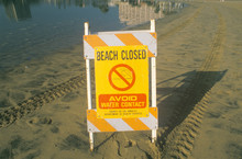 A Sign Reading ÒAvoid Water ContactÓ Warning People That A Beach At Marina Del Rey, Los Angeles, CA, Is Closed Due To Pollution