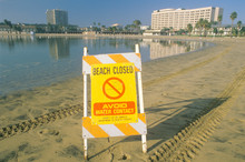 A Sign Reading ÒAvoid Water ContactÓ Warning People That A Beach At Marina Del Rey, Los Angeles, California, Is Closed Due To Pollution