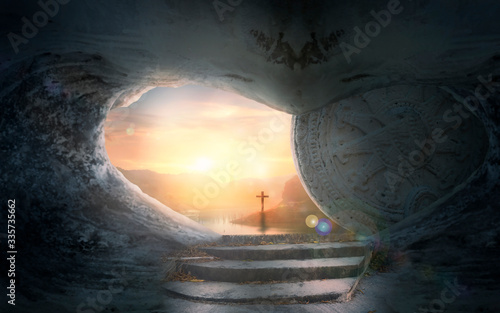 Fototapeta Easter Sunday concept: Tomb empty with cross on sunset background