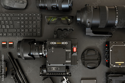 Fotografia, Obraz Top View of a Creative Filmmakers Office Desk with Lined up Camera and Gear