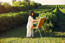 Woman Artist Painting With Oil...