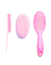 Hair Brushes And Comb On White...