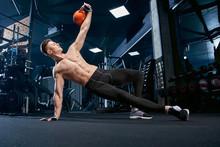 Shirtless Bodybuilder Doing Si...
