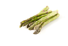 Organic Farming Asparagus Isolated On A White Background. Green Asparagus In Garden Ground, Isolated.