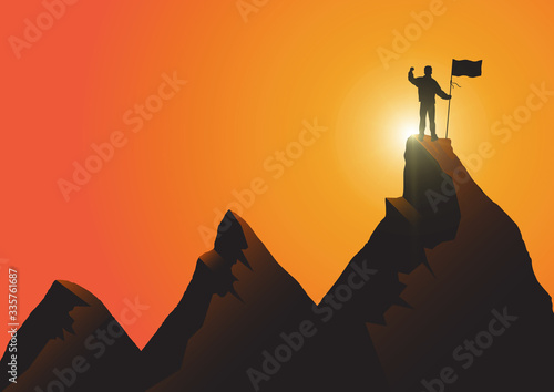 Fotografía Silhouette of man standing on top of the mountain with flag with fist raised up