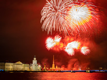 Salute In Saint Petersburg. Russia. Festive Evening In St. Petersburg. Volleys Of Salute Over The Neva And The Peter And Paul Fortress. Salute Over Vasilievsky Island And Palace Bridge.