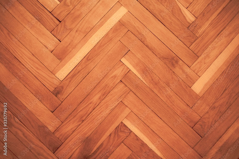 Fototapeta High angle view of a hardwood floor under the lights in a house