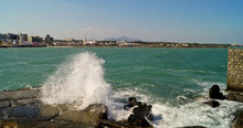 Powerful Waves Crushing On A Rocky Beach. Wave And Splashes On Beach. Sea Waves Hitting Rocks
