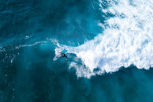 Surfer At The Top Of The Wave