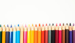A close-up of colorful crayons isolated on a white background