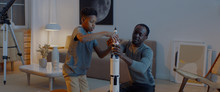 African American Father And Son Playing Together, Building Moon Landing Mission Rocket Together. Stay Home, Quarantine, Science