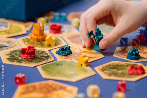Obraz Colorful board game figures and dice on the field, hobby - fototapety do salonu