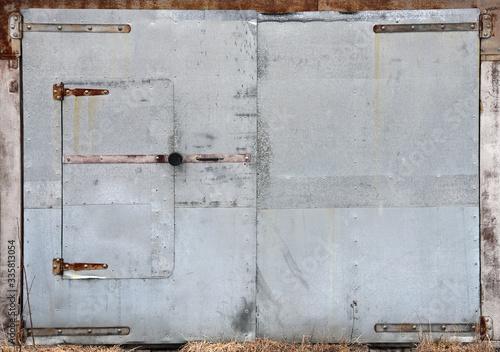 Metal old and shabby doors (gates). Vintage door texture.