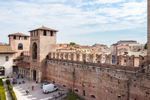 View From The Fortress Wall To The Inner Courtyard, The Corner Tower And The Tower Above The Entrance To Castelvecchio Castle In Verona, Italy.