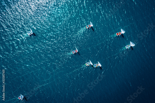 Fotografie, Obraz Small sailing boats on the lake during the competition