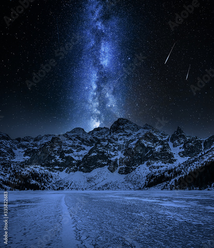 Snowy Morskie Oko mountain lake in winter at night Wall mural