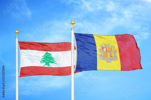Lebanon and Andorra  two flags on flagpoles and blue cloudy sky Wallpaper Mural