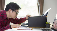 Business Owner Asian Man Using Printer For Business At Study Table In House,work From Home Concept