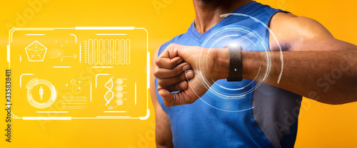 Carta da parati African American guy using fitness watch to monitor health and exercise on orang