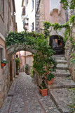 Fototapeta Perspektywa 3d - A narrow street in a small village in central Italy