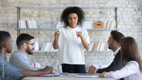 Fotografie, Obraz Serious african american businesswoman manager speaks in boardroom at meeting