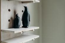 A Couple Black Penguin Figurin...