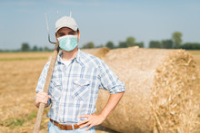 Farmer In His Field While Wear...