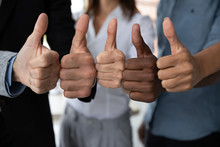 Close Up View Of Diverse Business Team People Hands Showing Thumbs Up Like Finger Gesture Recommendation Or Good Job Choice. Professional Multicultural Team Recommend Corporate Service.