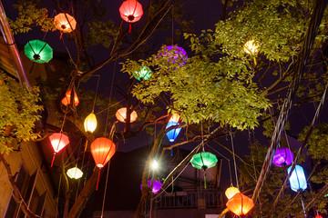 Obraz na płótnie Canvas Colourful lanterns hang outside a restaurant in Hanoi