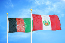 Afghanistan And Peru  Two Flags On Flagpoles And Blue Cloudy Sky