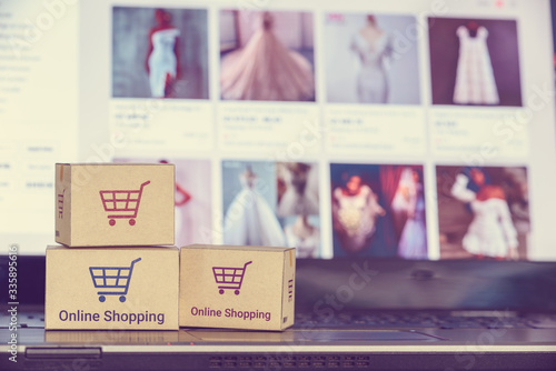 Online shopping / e-commerce and customer experience concept : Boxes with shoppi Canvas Print