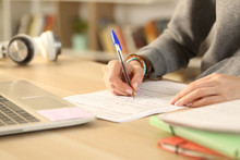 Student Hands Filling Out Form Document At Home