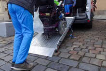 Assistant Helping Disabled Per...