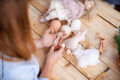 Fototapeta Workflow, masters of making handmade dolls