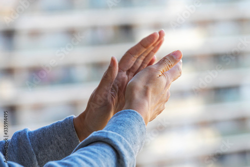 Woman hands applauding medical staff from their balcony Canvas Print