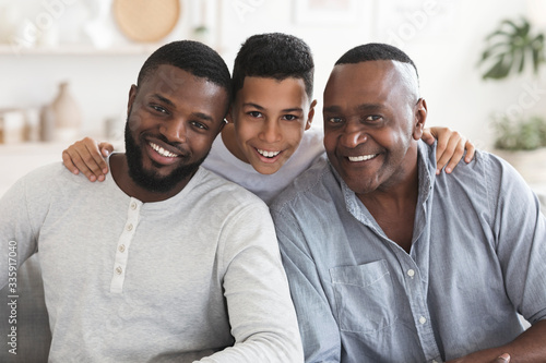 Fototapeta Happy black son, father and grandfather posing for family picture together obraz