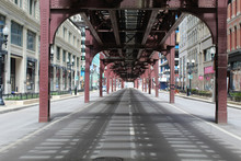 Nearly Deserted Wabash Avenue In Downtown Chicago Under The El Train Tracks During The COVID-19 Shelter-in-place Order