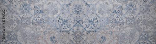 Fototapeta Old gray blue vintage shabby patchwork motif tiles stone concrete cement wall texture background banner  obraz