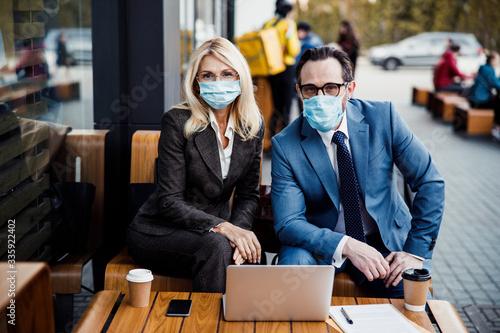 Entrepreneurs sitting at a business meeting outdoors Fototapeta