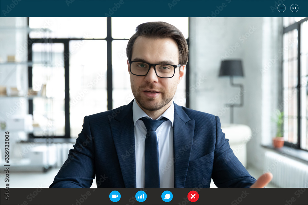 Fototapeta Head shot employer lead job interview with applicant laptop screen teleconference app view. Businessman talk with client by video call communicating distantly use modern videoconference and pc concept