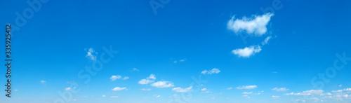 Obraz Blue Sky background with tiny Clouds. Panorama background - fototapety do salonu