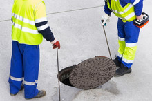 Sewerage Truck Service And Utility Workers For Cleaning Sewer Pipes In City Street
