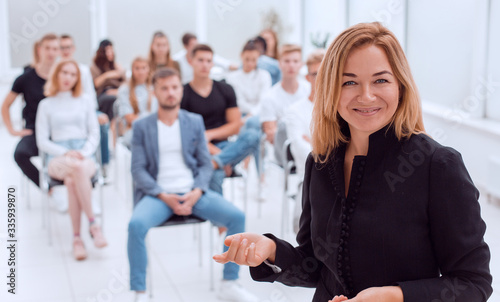 Leinwand Poster smiling business woman standing in conference room