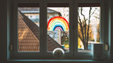 Fototapeta Tęcza - Close-up photo of painting rainbow on window