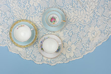 Pretty China Teacups On Pale B...