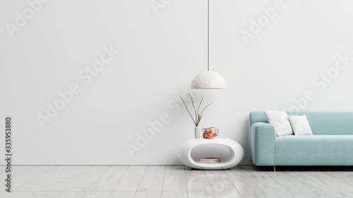 Obraz Empty living room with blue sofa, plants and table on empty white wall background. - fototapety do salonu