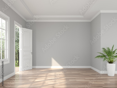 Foto Classical style empty entrance hall 3d render,The rooms have wooden floors and gray walls ,decorate with white moulding,there are open door looking out to the balcony and nature view