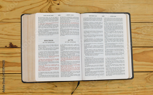open bilingual bible book on Acts, Spanish and english Canvas Print