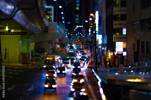 Fototapeta A night miniature neon street in Shibuya Tokyo tiltshift obraz na płótnie
