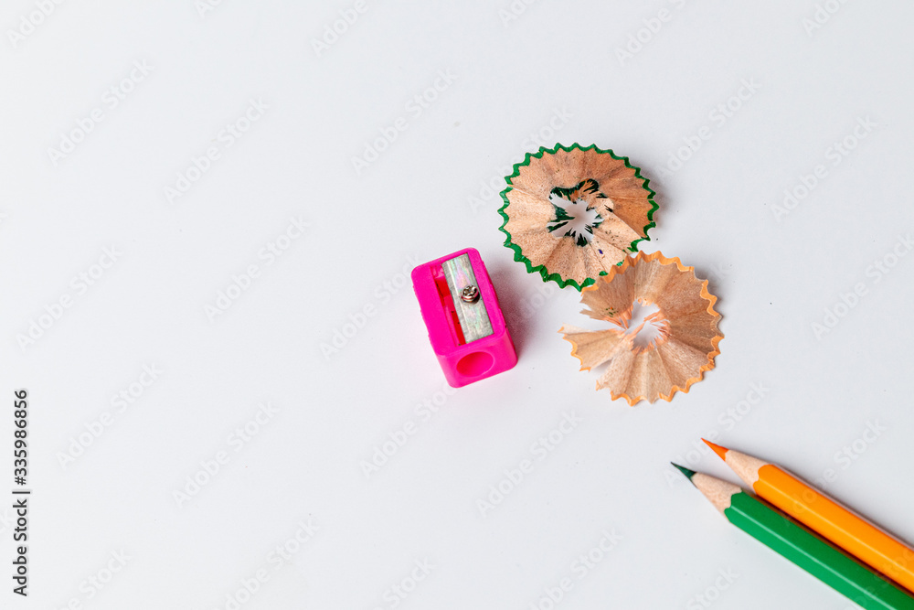 Color pencils with sharpener on white background. - obrazy, fototapety, plakaty